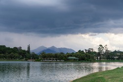 Lake shore with a cafe on the background of mountains and clouds, Dalat Vietnam