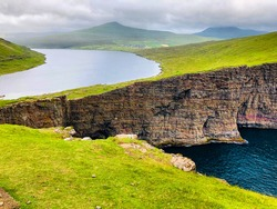 Lake Sorvagsvatn in the Faroe Islands.  The most beautiful cliffs and impossible looking lake
