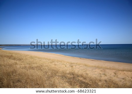 Lake Superior - Grassy shoreline and beach of a North American Great Lake. - stock photo