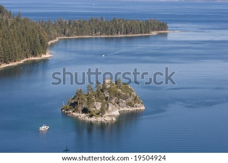 Lake Tahoe is a large freshwater lake in the Sierra Nevada mountains of the United States. It is located along the border between California and Nevada - stock photo