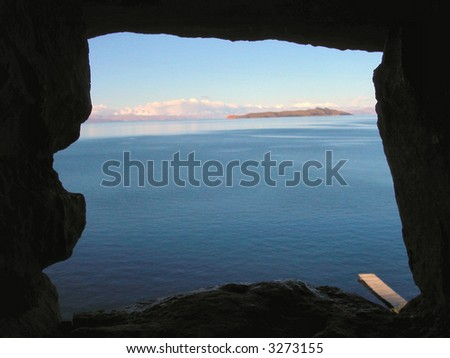 Lake Titicaca and Island of the moon as seen through the stone window of ancient Inca ruins.