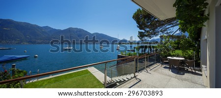 Lake view from the balcony of modern villa #296703893