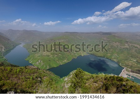 Lake view from viewpoint Banjska stena in Tara national park of Serbia. Touristic site, observation point with view over lake Perucac, Drina canyon steep cliffs and Bosnia slopes. Stock photo ©