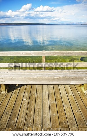 Lake View Yellowstone Lake, Wyoming. Wood Bench in the Famous Yellowstone National Park, USA. - stock photo