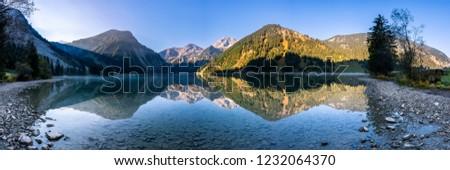lake Vilsalpsee in the Allgäu Alps in autmn #1232064370