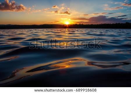 Lake wave close up, low angle view, sunset shot