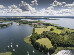 Lake Wigry National Park. Suwalszczyzna, Poland. Blue water and whites clouds. Summer time. View from above.