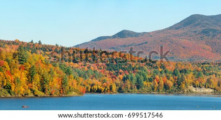 Lake with Autumn foliage and mountains in New England Stowe #699517546
