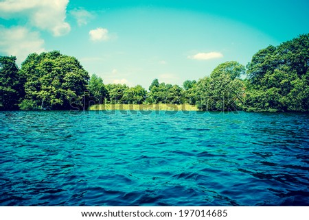 Lake with blue water and green trees