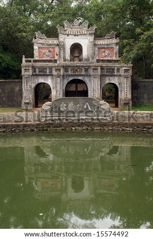 Lake with green water and gate, Hue, central Vietnam - stock photo