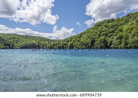 Lakes with blue water in the middle of a mountain landscape. National Park Plitvice Lakes. Croatia. #689904739