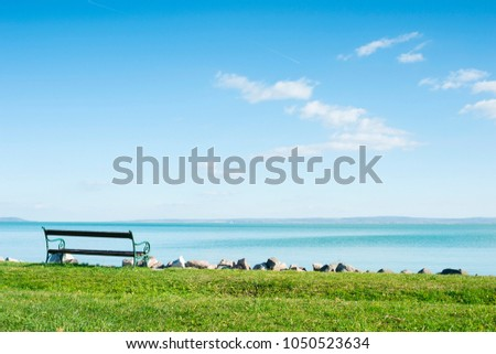 lakeside park bench  - Shutterstock ID 1050523634
