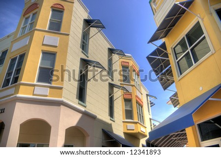 Lakewood Ranch, Florida, has a main street section in the style of turn-of-the-century small town USA, with luxury condo above the shops.  However, there awning treatment is very modern.