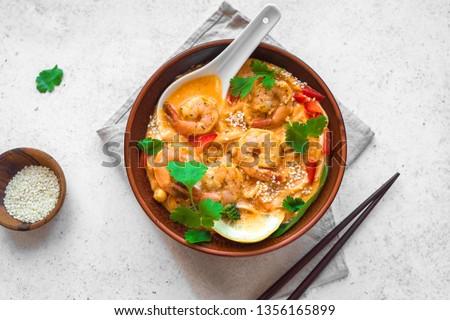 Laksa Shrimp Soup. Prawn noodle laksa soup on white background, top view, copy space. Asian Malaysian food.