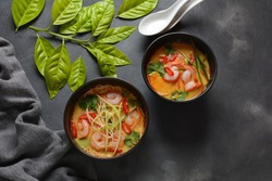 Laksa Soup – a Malaysian  Coconut Curry  Soup with shrimps over rice noodles topped with fresh bean spouts,cucumber, lime, red chili pepper and cilantro