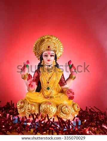 Lakshmi - Hindu goddess, Goddess Lakshmi. Clay diya lamps lit with Goddess Lakshmi during Diwali Celebration. Greetings Card Design Indian Hindu Light Festival called Diwali - Shutterstock ID 335070029