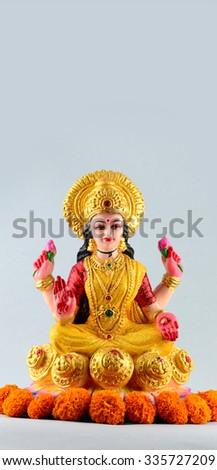 Lakshmi - Hindu goddess ,Goddess Lakshmi. Goddess Lakshmi during Diwali Celebration. Greetings Card Design Indian Hindu Light Festival called Diwali - Shutterstock ID 335727209
