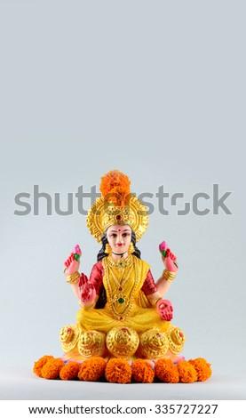 Lakshmi - Hindu goddess ,Goddess Lakshmi. Goddess Lakshmi during Diwali Celebration. Greetings Card Design Indian Hindu Light Festival called Diwali - Shutterstock ID 335727227
