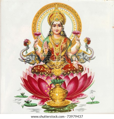 Lakshmi -  Hindu goddess of wealth, prosperity,light,wisdom,fortune and fertility sitting on flower of red lotus, India, Asia - stock photo