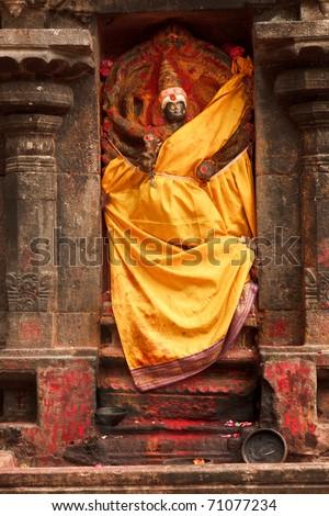 Lakshmi image. Hindu goddess bas relief  in Hindu temple. Arunachaleswar Temple, Tiruvannamalai, Tamil Nadu, India