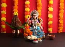 Lakshmi pujan - godess laxmi idol, Copper Kalash, coconut, saweets and haldi kumkum