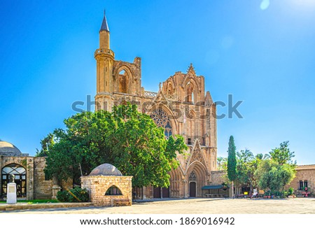 Lala Mustafa Pasha Camii Mosque or Old Cathedral of Saint Nicholas medieval building with minaret in Famagusta historical city centre, clear blue sky in sunny day, Cyprus Stok fotoğraf ©