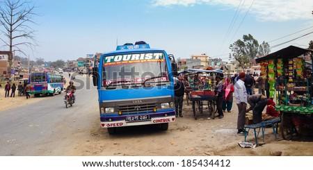 Lamahi, Nepal - 5 February 2014: A long-distance bus headed for Nepalgunj takes a rest break in Lamahi bus park in the Terai region
