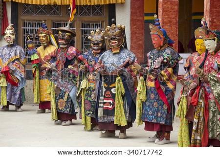 LAMAYURU, INDIA - JUNE 13, 2015: An unidentified buddhist lamas dressed in mystical mask dancing Tsam mystery dance in time of Yuru Kabgyat Buddhist festival at Lamayuru Gompa, Ladakh, North India #340717742