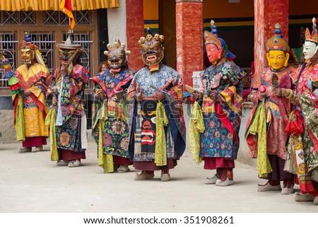 LAMAYURU, INDIA - JUNE 13, 2015: An unidentified buddhist lamas dressed in mystical mask dancing Tsam mystery dance in time of Yuru Kabgyat Buddhist festival at Lamayuru Gompa, Ladakh, North India #351908261