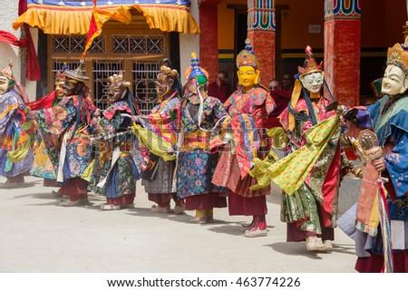 LAMAYURU, INDIA - JUNE 13, 2015: Unidentified buddhist lamas dressed in mystical mask dancing Tsam mystery dance in time of Yuru Kabgyat Buddhist festival at Lamayuru Gompa, Ladakh, North India #463774226