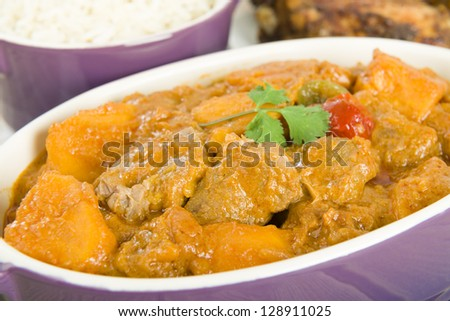 Lamb and sweet potato peanut stew served with white rice. Caribbean and West African dish.