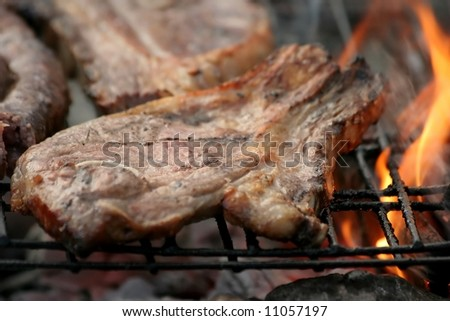Lamb Chop grilling on open flames of a barbecue