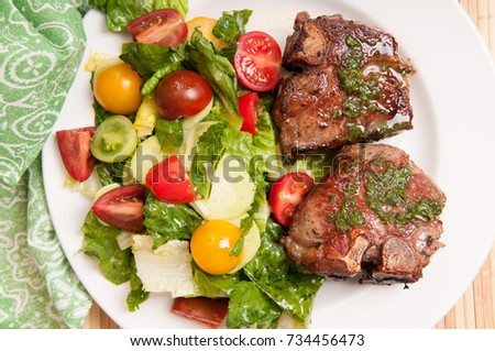 lamb chops with mint and summer salad, a ketogenic diet meal #734456473