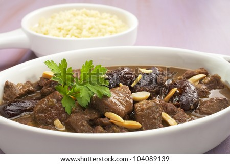 Lamb cooked with ginger, cinnamon, dates, honey and lemon juice and garnished with almonds, served with couscous.