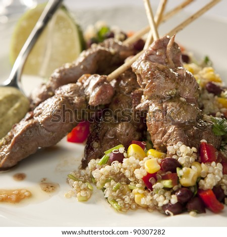 Lamb kebab and quinoa with vegetables (corn, bell pepper)