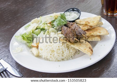 Lamb Kebab Skewers with Basmati Rice Naan Bread and Salad