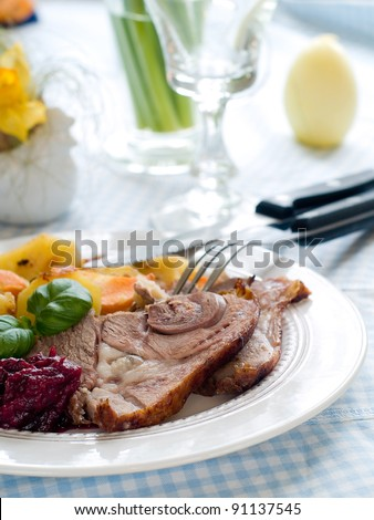 Lamb meat with potatoes and carrot, selective focus