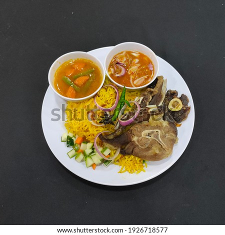 Lamb Mendy rice by malay cook with sauce and soup on black table Stock photo ©