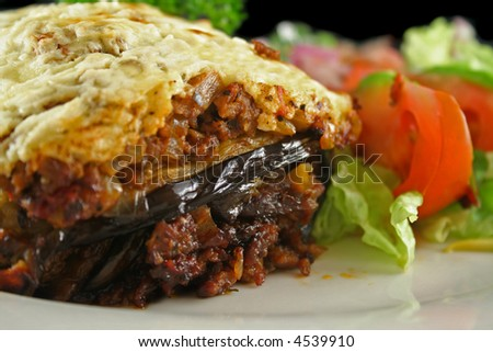 Lamb moussaka with egg plant cheese and salad.