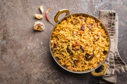 Lamb pilaf in a bowl on stone background, top view with copy space