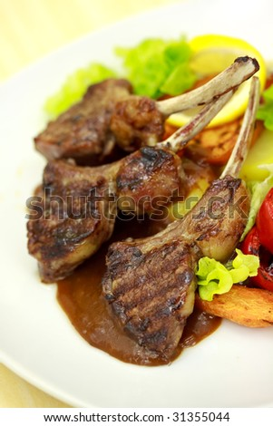 Lamb Rack - grilled,with sauce,peppercorn,baked tomato