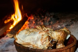 lamb roasted in a traditional wood-fired oven