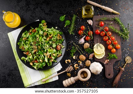 Lamb's lettuce salad with walnuts with mustard dressing #357527105