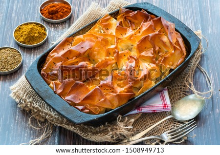Lamb samosa pie - popular Indian dish with a savoury filling.