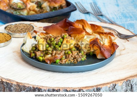 Lamb samosa pie - popular Indian dish with a savoury filling