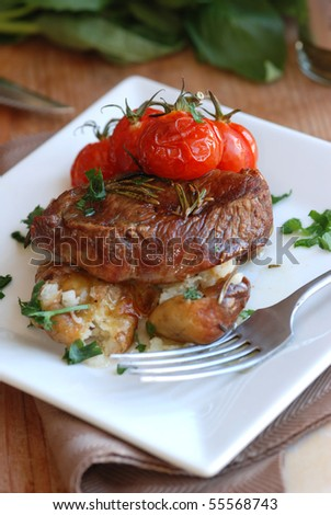 Lamb steak with new potatoes and cherry tomatoes - stock photo