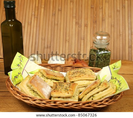Laminar bread rolls with garlic and parsley in basket with decoration. Vintage style