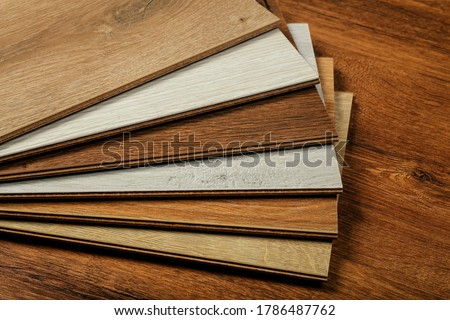 Laminate background. Samples of laminate or parquet with a pattern and wood texture for flooring and interior design. Production of wooden floors Stok fotoğraf ©