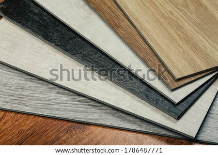 Laminate background. Samples of laminate or parquet with a pattern and wood texture for flooring and interior design. Production of wooden floors Zdjęcia stock ©