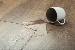 Laminate background.. Wooden laminate and parquet board with spilled water. Moisture protection of a floor